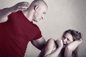 Woman victim of domestic violence and abuse. Husband beats his wife